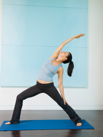 A woman holding a yoga pose